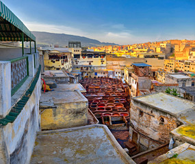 old dye-houses in a historical part of the city of Fes, on a sunset