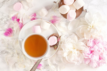 Beautiful still life with tea cup and peonies.Top view