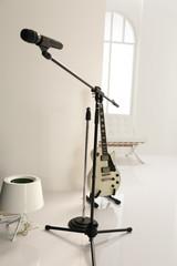 standing white guitar