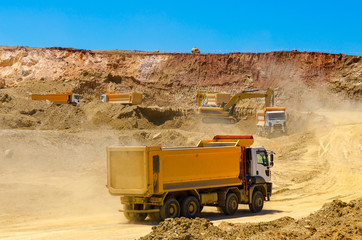set of trucks and the excavator work in career at mining