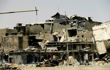 Buildings destroyed by clashes are seen in the Old City of Mosul
