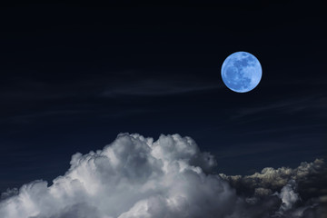 Blue full moon and cloud  in the dark sky at night , color effect