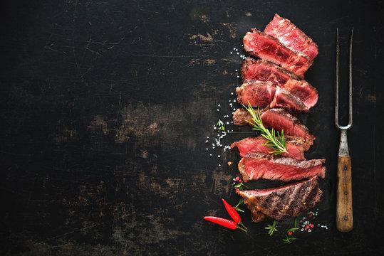 Sliced medium rare grilled beef ribeye steak