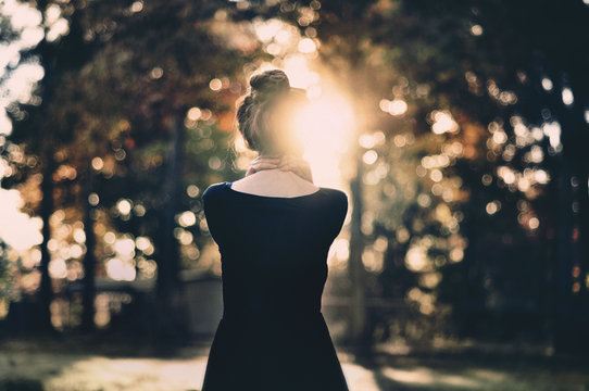 Young woman's back in autumn
