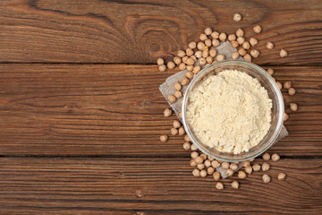 Chickpea flour in a wooden spoon