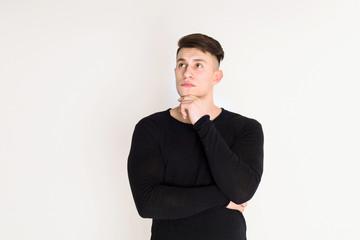 Pensive young man studio portrait, boy style