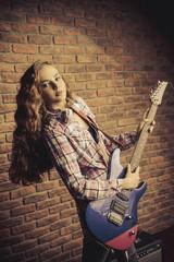 girl plays guitar