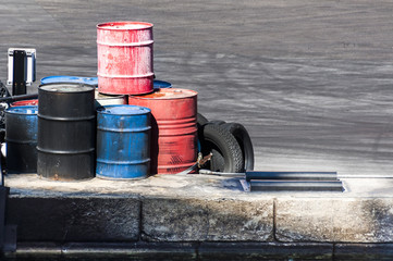 barrels on the dock along with some tires