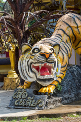 KRABI, THAILAND MARCH 16, 2017 : Tiger statue at Tiger Cave Temple , Krabi , South of Thailand.