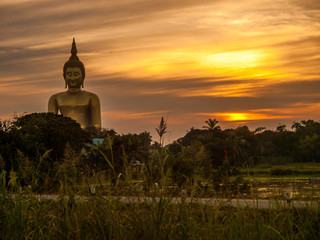 big budha ' statue  with sunset