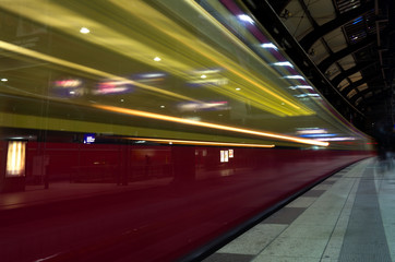 Train is rapidly passing the platform in Berlin Germany ling exposure motion blur