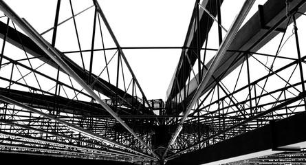 Large metal structure of the ferris wheel in b&w