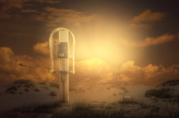 Payphone is found in the murky desert