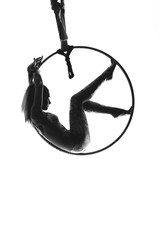 girl on the air ring gymnastics silhouette isolated on the white background