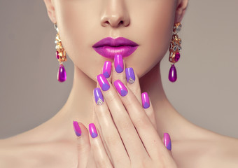 Aluminium Prints Manicure Beautiful girl model with fashion violet make-up and purple design manicure on nails . Jewelry and cosmetics , large violet earrings