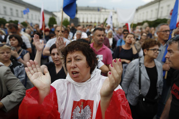 People gather in front of the Supreme Court during a protest against the Supreme Court legislation in Warsaw