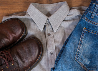 set of cool fashion men's casual outfit on wooden table. top view.
