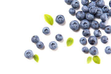 Fresh blueberries and leaves, berry frame isolated on white background, top view