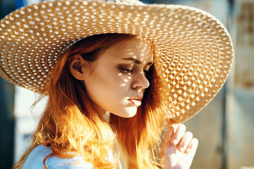 Beautiful young woman in a hat, portrait, sun, light, summer