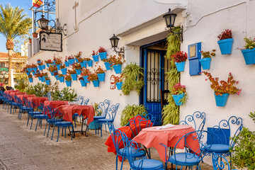 Picturesque outdoors cafe in the white town of Mijas, Spain.