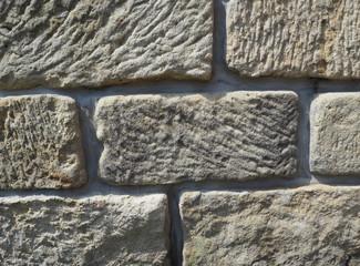 sandstone wall from old big blocks beige background