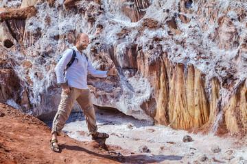 Traveler posing for a photograph near the salty glacier, Iran.
