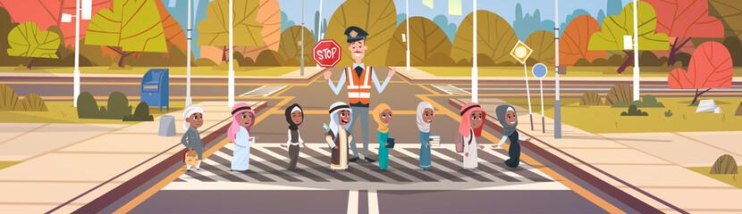 Policeman Guard Helping Group Of Arab School Children To Cross Road On Crosswalk Vector Illustration