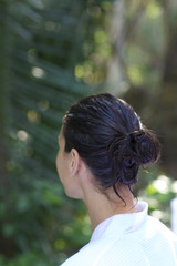 Woman in a spa robe looking away