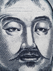 Genghis Khan portrait on Mongolia 1000 Tugrik banknote closeup macro. Founder and Great Khan (Emperor) of the Mongol Empire.