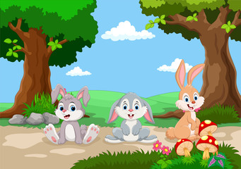 Cute little rabbits cartoon with a background of a beautiful garden