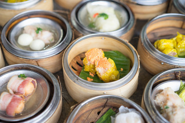 Chinese yumcha dimsum set in bamboo container.