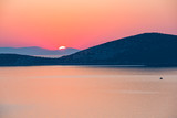 Colorful sunrise over sea in Greece