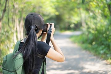 Woman photographer taking photo.