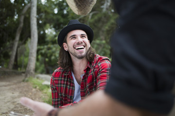 Man looking at male friend while sitting in park