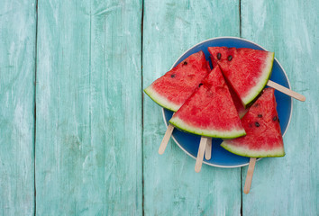 watermelon pops for a picnic on turquoise background