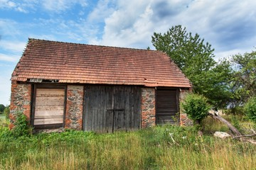 An old abandoned barn in the countryside in the Czech Republic. Summer day at the farm.