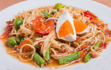 "Papaya salad on top with salted egg ""Somtum"" in Thai, Famous Thai food."