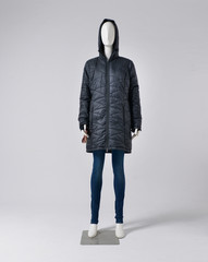 full-length female mannequin in coat dressed in jeans-gray background