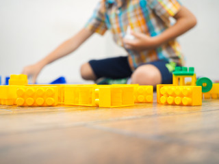 Details of the toy construct on the background of the playing child