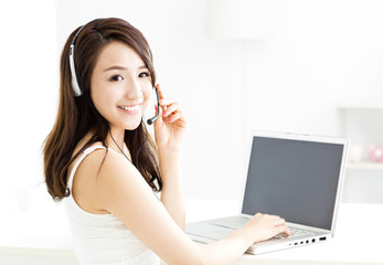 beautiful young smiling woman with  laptopand headphone