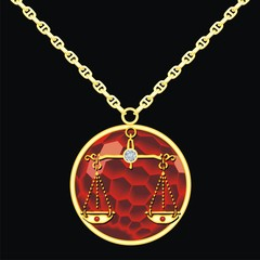Ruby medallion on a chain with a libra