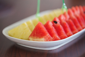 slices of watermelon and pineapple on a table