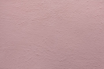 Pink painted stucco wall. Background texture