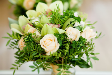 Wedding bouquet with roses and green cymbidium orchids