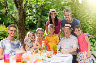 Family reunion around a picnic table in a beautiful garden