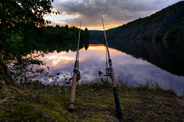 Ingelijste posters Vissen Freshwater fishing with rods on Vltava at sunset, Czech Republic