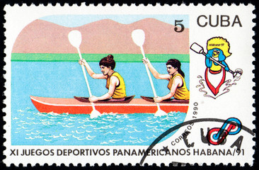 UKRAINE - CIRCA 2017: A postage stamp printed in Cuba shows Kayaking from series 11th Pan American Games, circa 1990