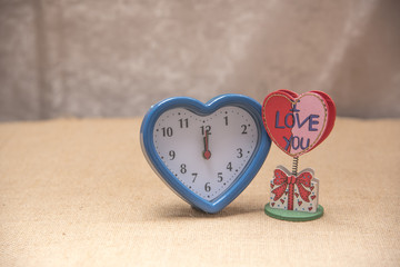 Blue heart watch on Brown background