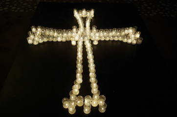 Cross made with candles
