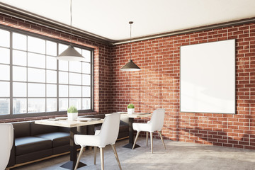 Brick cafe interior with a vertical poster, side
